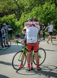 LVIV, UKRAINE - MAY 2018: Emotional greeting at the finish of a cyclist`s athlete and rewarding him with a medal. Emotional greeting at the finish of a cyclist`s stock photography
