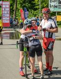 LVIV, UKRAINE - MAY 2018: Emotional greeting at the finish of a cyclist`s athlete and rewarding him with a medal. Emotional greeting at the finish of a cyclist`s royalty free stock photos
