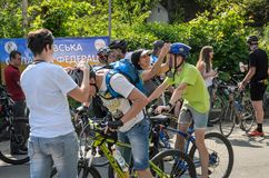 LVIV, UKRAINE - MAY 2018: Emotional greeting at the finish of a cyclist`s athlete and rewarding him with a medal. Emotional greeting at the finish of a cyclist`s royalty free stock photo