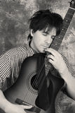 Emotional guitarist. Black and white Royalty Free Stock Image