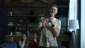 Emotional guy performing song in home karaoke stock footage