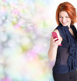 Emotional happy woman with red hair and a telephone Stock Photos