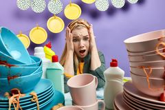 Emotional helpless woman in panic , depressed with washing process royalty free stock images