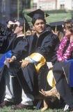 Emotional high school graduates Stock Image