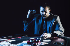 Emotional high stakes poker player Royalty Free Stock Image
