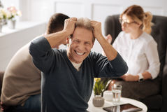 Emotional hysterical man holding his head Stock Photo