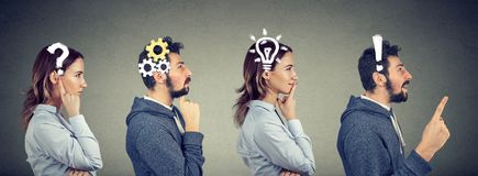 Thoughtful man and woman thinking solving together a common problem. Emotional intelligence. Thoughtful men and women thinking solving together a common problem royalty free stock photo