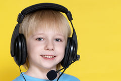 The emotional kid in ear-phones Stock Image