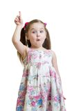 Emotional kid girl points a finger Royalty Free Stock Images