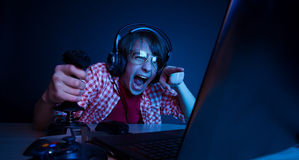 Emotional kid play video game Royalty Free Stock Photo
