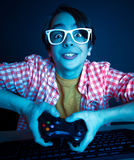 Emotional kid play video game Royalty Free Stock Images