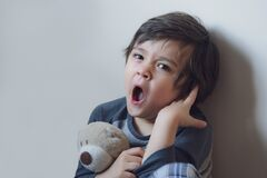 Free Emotional Kid Yawning, Sleepy Child Siting Alone In The Coner And Looking At Camera, Indoor Portrait Tired Boy Get A Cold During Royalty Free Stock Images - 200809919
