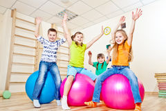 Emotional kids. Jumping on gymnastic balls stock images