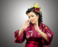 Emotional kimono woman with flowers in her hair Royalty Free Stock Photos