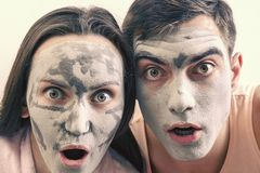Emotional large portrait of a married couple in masks for the face of clay. day Spa, Wellness, skincare.  royalty free stock photo
