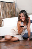 Emotional Latin girl with wine Stock Photo