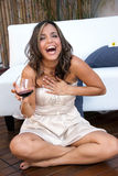 Emotional Latin girl with wine Stock Image