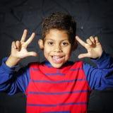 Emotional little black afro-american boy portrait Stock Images
