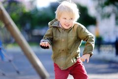 Emotional little boy having fun on outdoor playground Royalty Free Stock Photo