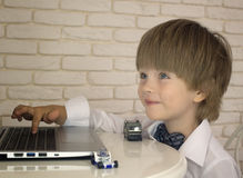Emotional little boy using laptop Royalty Free Stock Photography