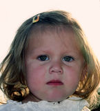 Emotional Little Girl. Closeup of the emotional face of a little girl stock photo