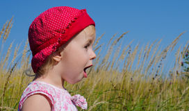 Emotional Little Girl with funny Face Expression Stock Image