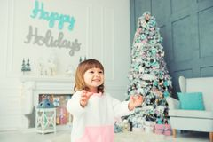 Emotional little girl. Happy New Year. Pleasure, happiness and delight from New Year`s gifts. Emotional little girl. Happy New Year. Pleasure, happiness and Royalty Free Stock Photography