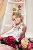Emotional little girl posing in vintage studio Stock Images