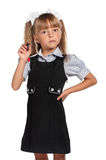 Emotional little girl in school uniform Royalty Free Stock Photography