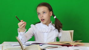 Emotional little girl solves a very difficult task stock video footage
