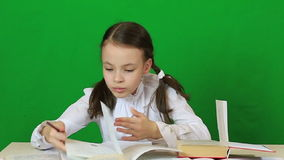 Emotional little girl solves a very difficult task stock footage