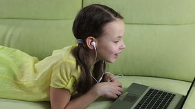 Emotional little girl talking on Skype at laptop stock footage