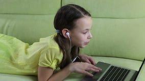 Emotional little girl talking on Skype at laptop. stock video footage