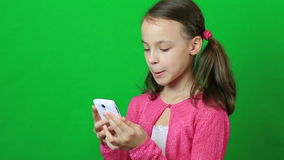 Emotional little girl talking on Skype at phone stock video footage