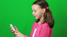 Emotional little girl talking on Skype at phone stock footage