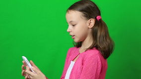 Emotional little girl talking on Skype at phone. stock video