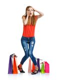 Emotional lovely woman with shopping bags over white Royalty Free Stock Photography