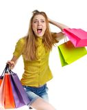 Emotional lovely woman with shopping bags over white Stock Photos