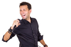 Emotional male singer with microphone. In hand Royalty Free Stock Photo