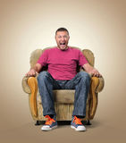 Emotional male spectator in the chair. Stock Photos
