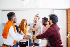 Emotional male wearing party hat is giving thank for surprise. Closeup photo of emotional male with closed eyes wearing party hat is giving thank for surprise Stock Photos