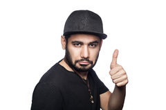 Emotional man with black t-shirt and cap. Stock Photo