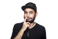 Emotional man with black t-shirt and cap. Royalty Free Stock Images