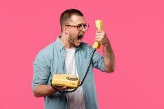 emotional man in eyeglasses screaming at handset isolated