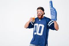 Emotional man fan in blue t-shirt wearing fan finger royalty free stock photo