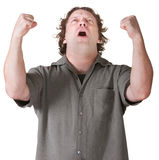 Emotional Man with Fists Up. Emotional man screaming with fists in mid air Royalty Free Stock Photography
