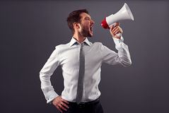 Emotional man in formal wear using megaphone Royalty Free Stock Photo