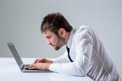 Emotional man and laptop Royalty Free Stock Image