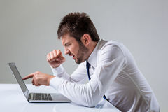 Emotional man and laptop Stock Images