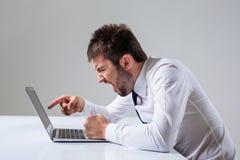 Emotional man and laptop Royalty Free Stock Photo